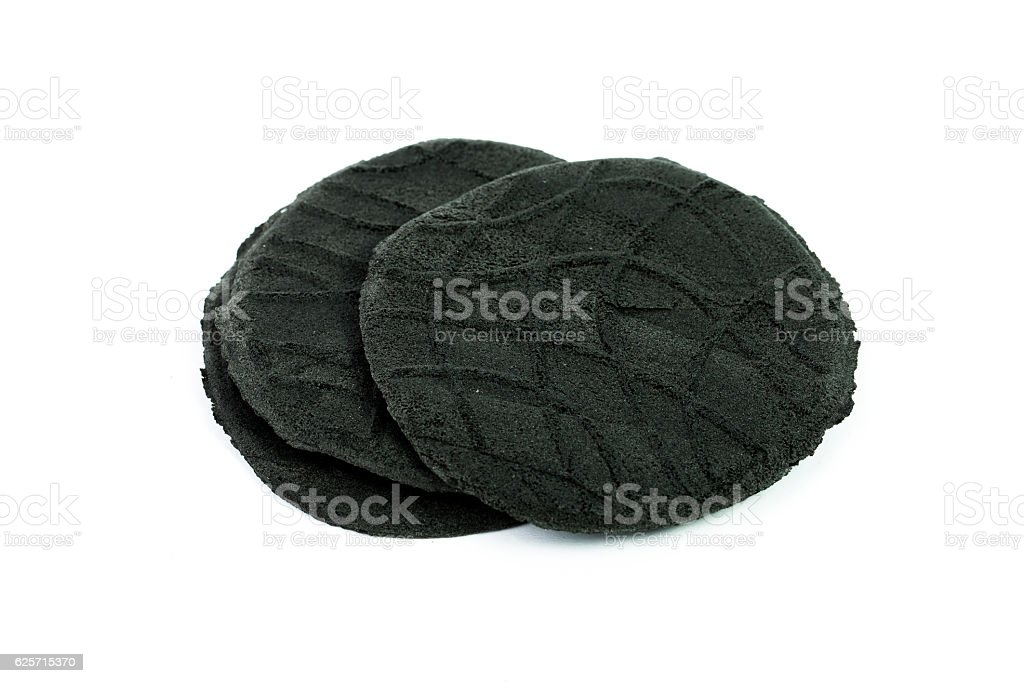 Organic active carbon charcoal cookies on white background. stock photo