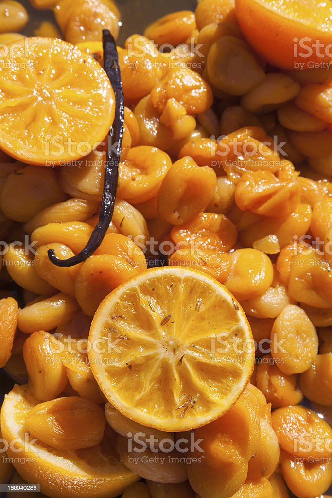 Organic apricots cooked in superior white wine stock photo