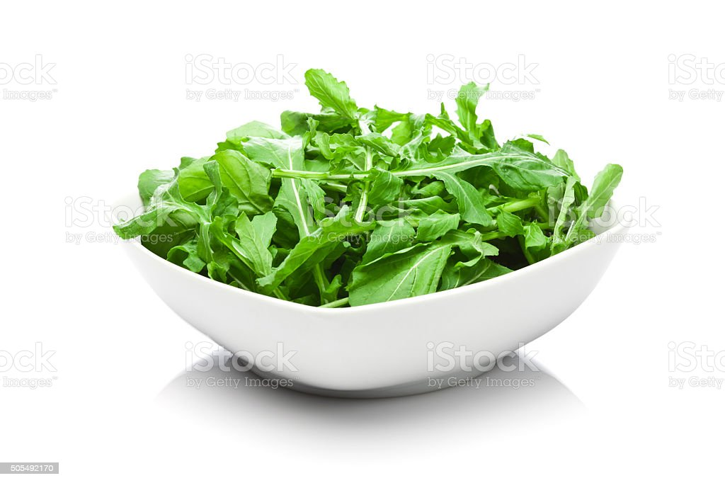 Organic arugula bowl isolated on white background stock photo