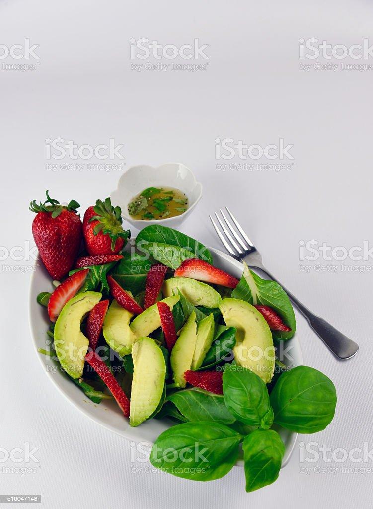 Organic Avocado Strawberry Spinach Salad royalty-free stock photo