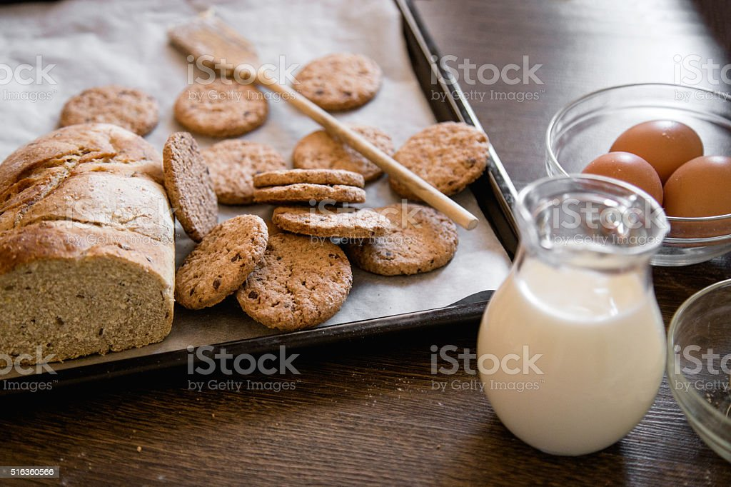 Organic bread and cookies in coocking pan stock photo