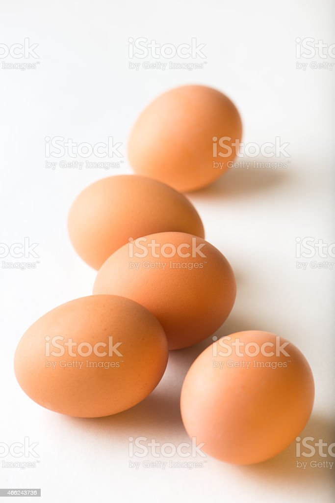 organic, brown eggs isolated on white background stock photo