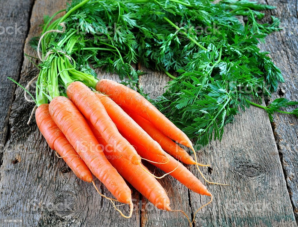 organic carrots on a wooden background stock photo