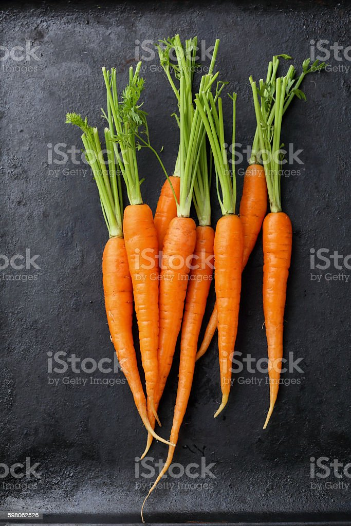 Organic carrots on black background stock photo