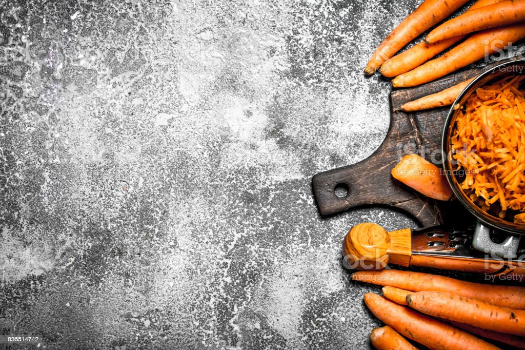 Organic carrots. On rustic background. stock photo