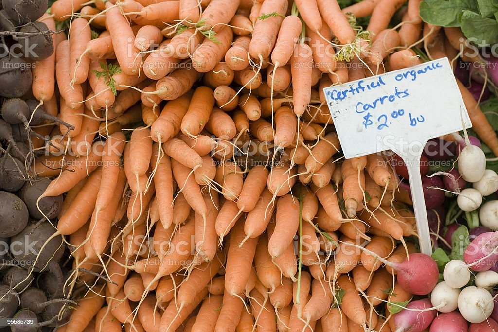 Organic carrots piled high at a farmers market royalty-free stock photo