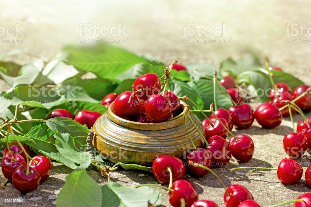 Organic cherry in rustic bowl stock photo