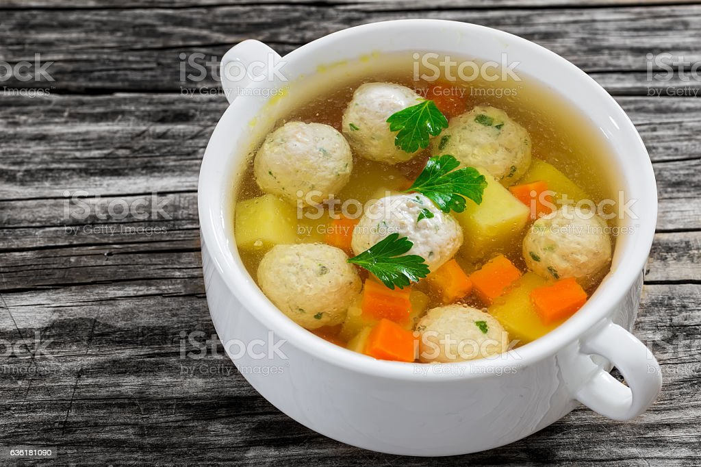 organic chicken soup with meatballs, carrot and potato stock photo