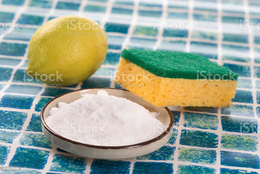 Organic cleaners. White vinegar, lemon and sodium bicarbonate. stock photo