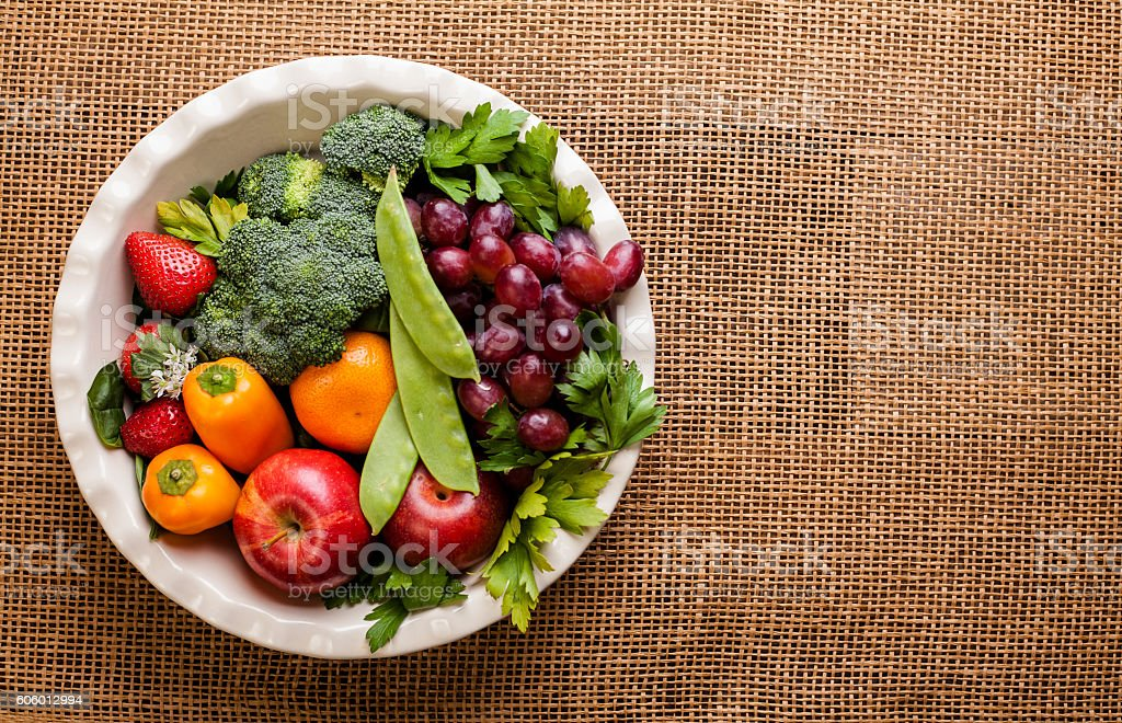 Organic colorful fruits, vegetables on burlap table. stock photo