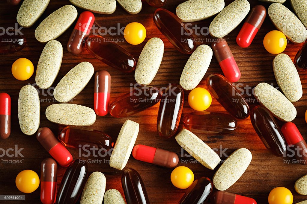 Organic dietary treatment, vitamin capsules stock photo
