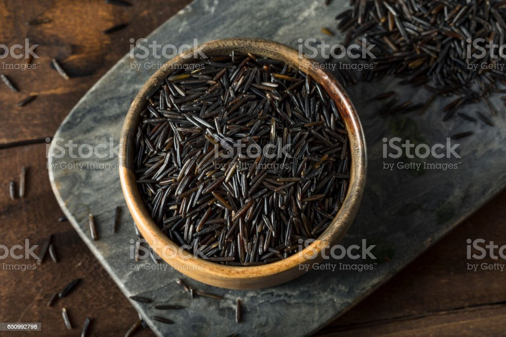Organic Dry Black Wild Rice stock photo