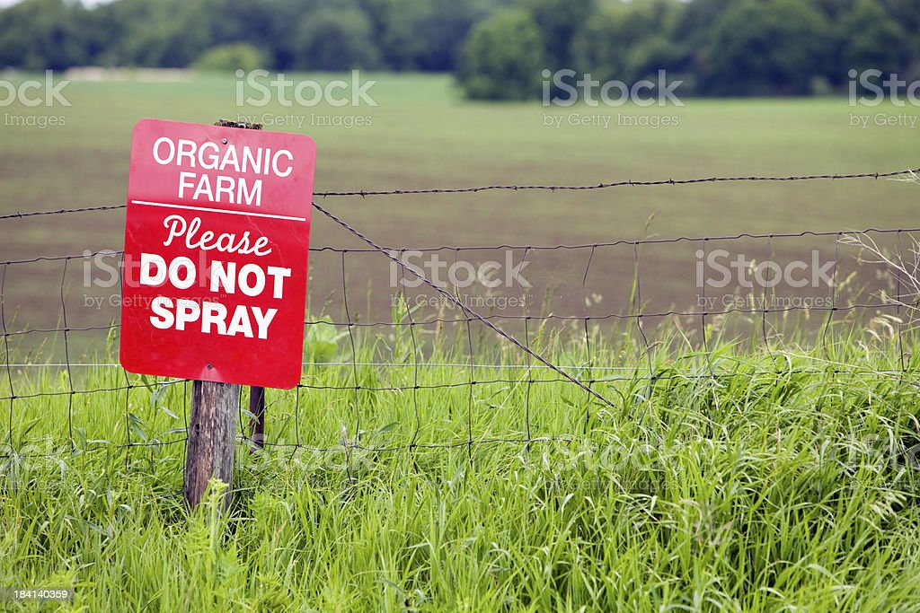 Organic Farm Sign at the edge of a Field stock photo