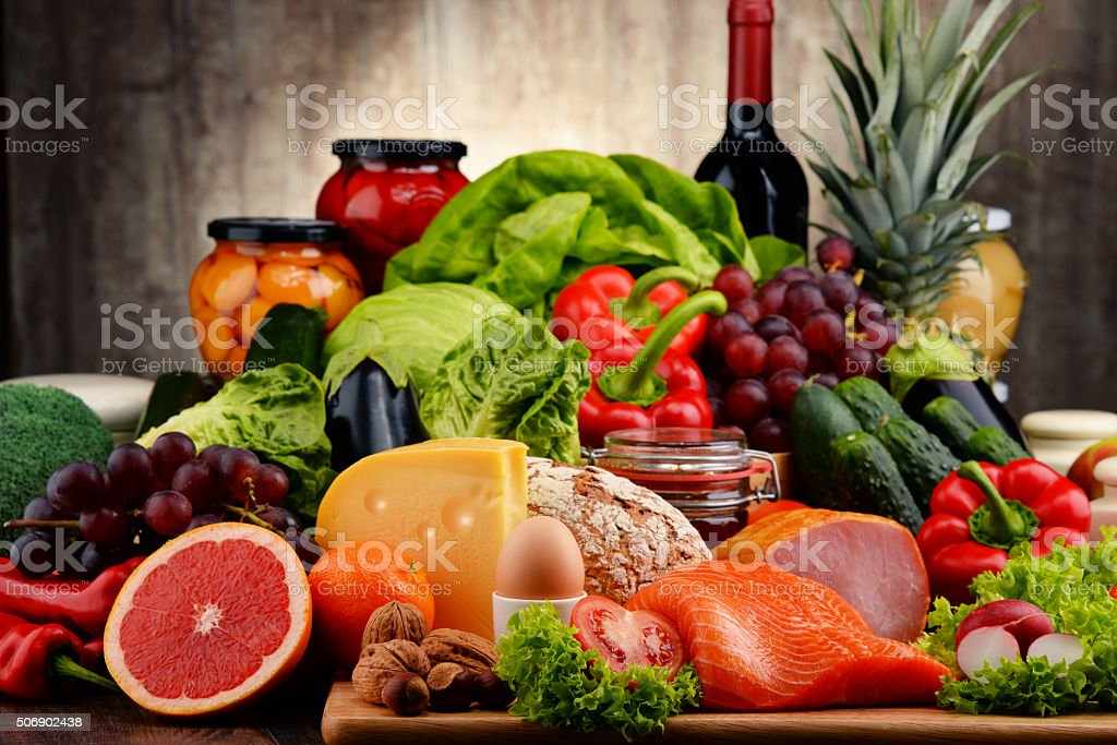 Variety of organic food including vegetables fruit bread dairy and...