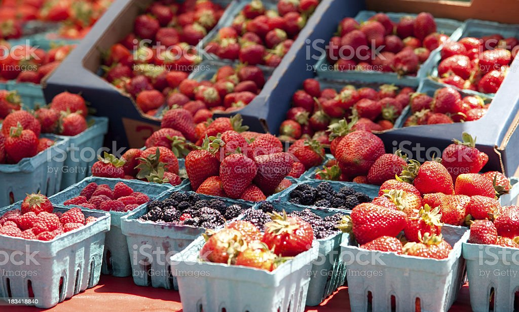 Organic fresh strawberries at the produce market stock photo