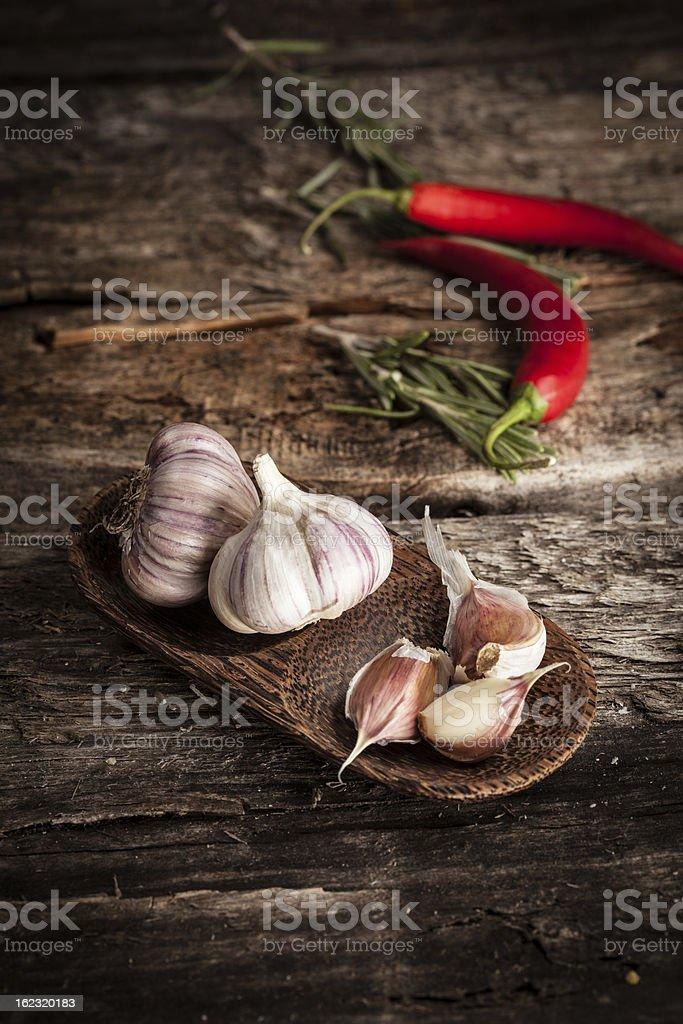 Organic garlic and hot pepper royalty-free stock photo