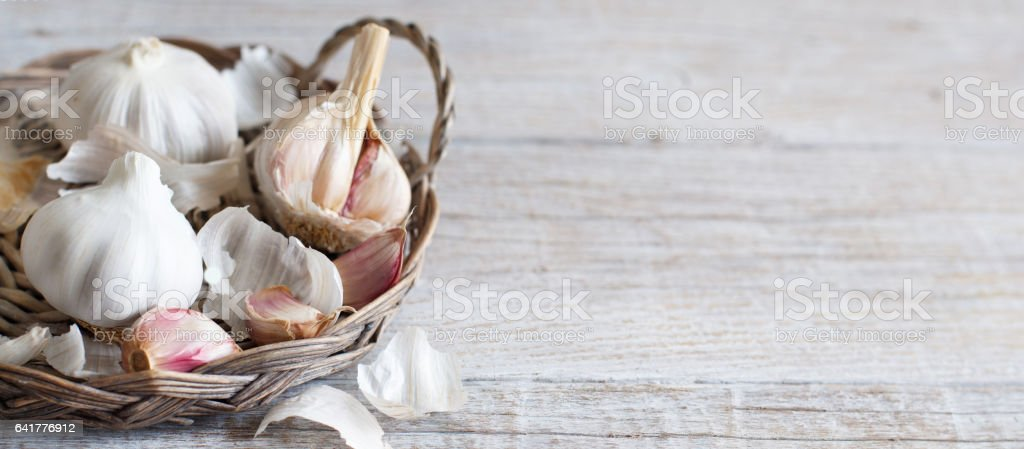 Organic garlic on wooden table stock photo