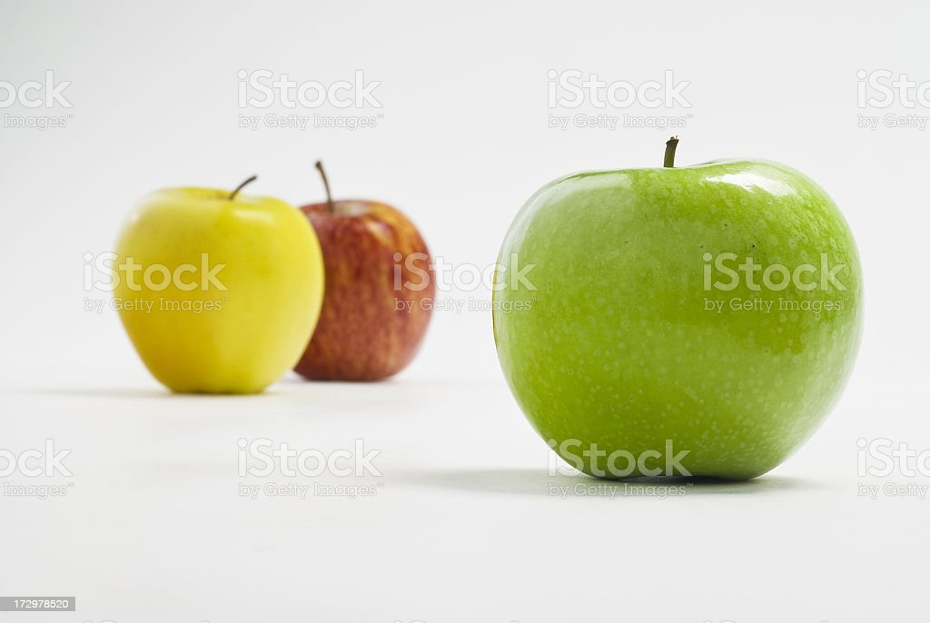 Organic Granny Smith Apple, Gala and Yellow Delicious in Background royalty-free stock photo