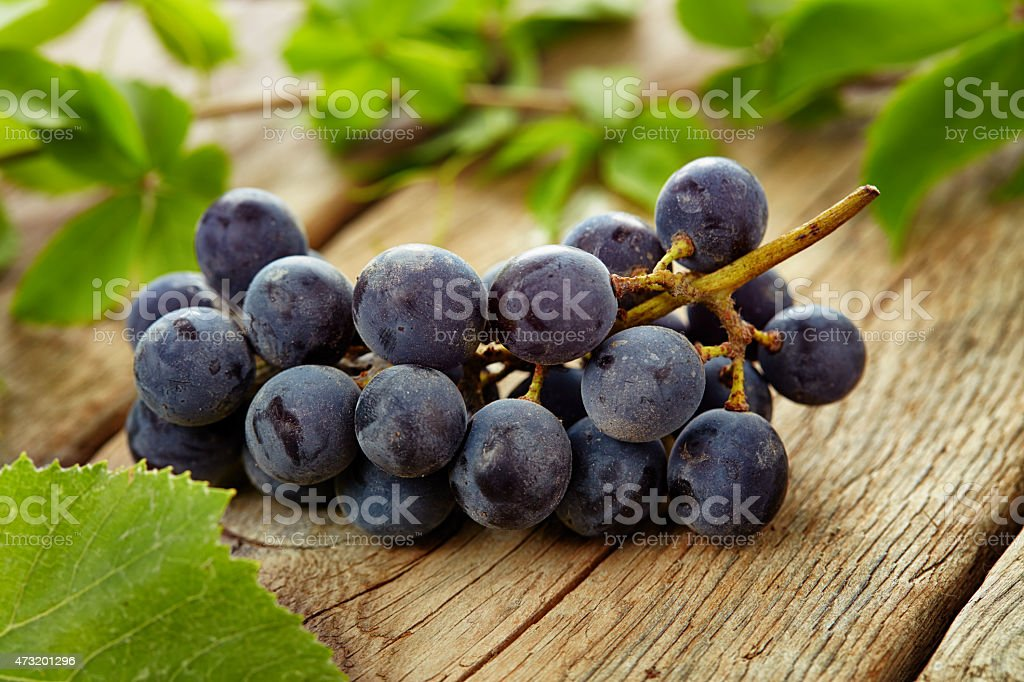 Organic grapes on wooden table stock photo