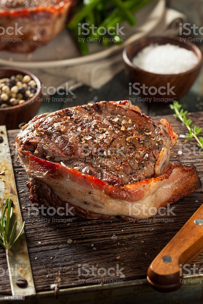 Organic Grass Fed Bacon Wrapped Sirloin Steak stock photo
