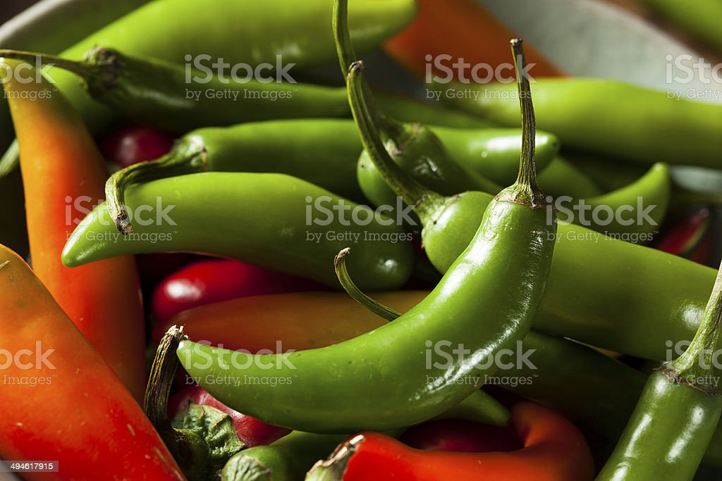 Organic Green Spicy Serrano Peppers stock photo
