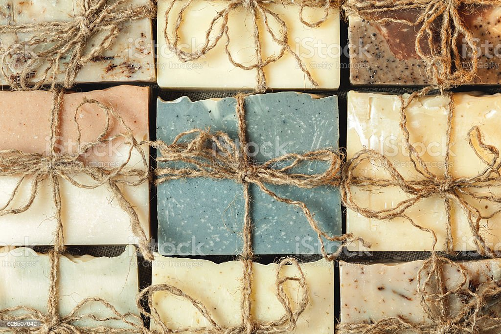 Organic handmade soap with cinnamon on wooden background stock photo