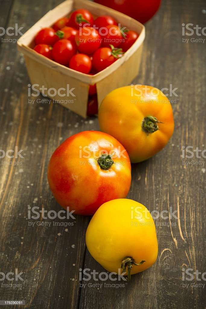 Organic Heirloom Tomatoes On Wood royalty-free stock photo