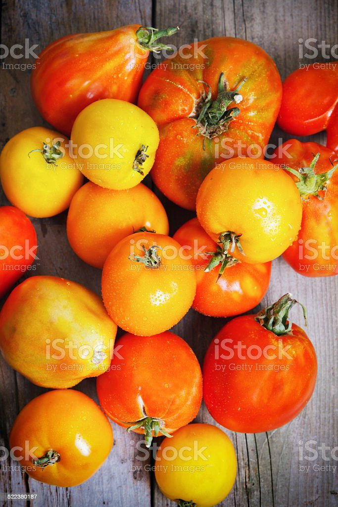 Organic Heirloom Tomatoes On Wood stock photo