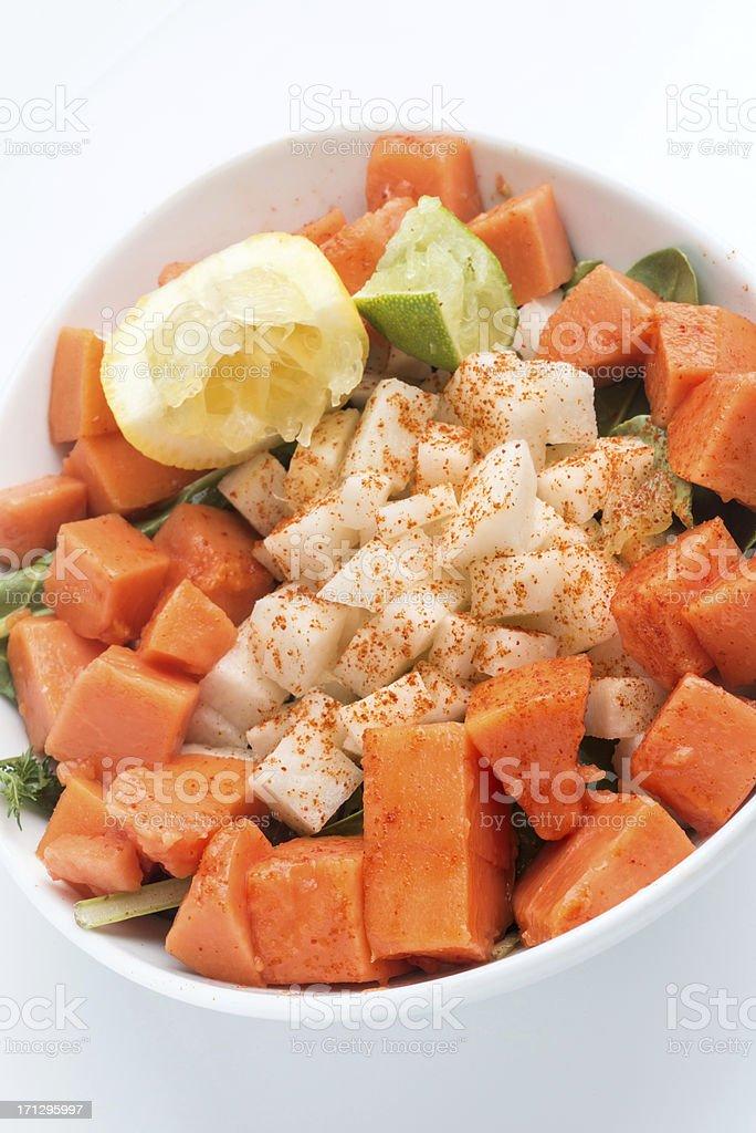 Organic Jicama and Papaya Salad (vegan cuisine) stock photo