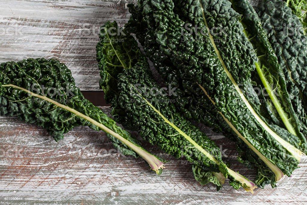 Organic Lacinato Kale wood table stock photo