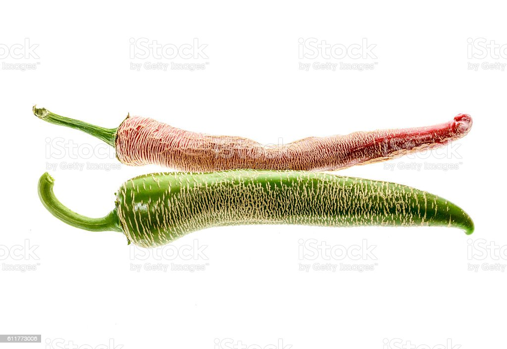Organic Macedonian Fringed hot chili peppers with green stem. stock photo