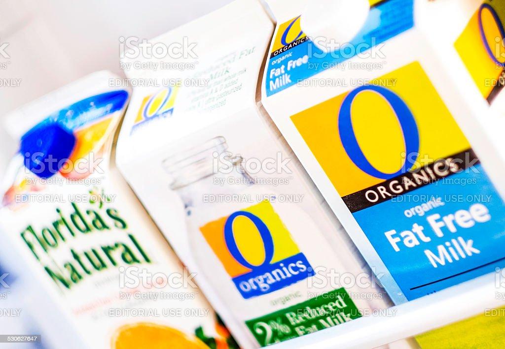 Organic milk and orange juice in refrigerator stock photo