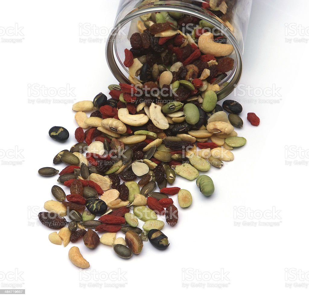 organic mixed nuts and dry fruits stock photo