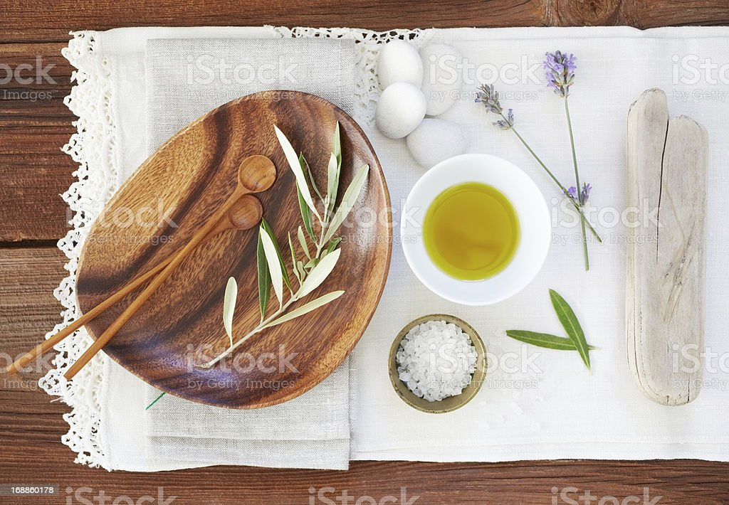 Organic oil and salt with lavender on table cloth stock photo