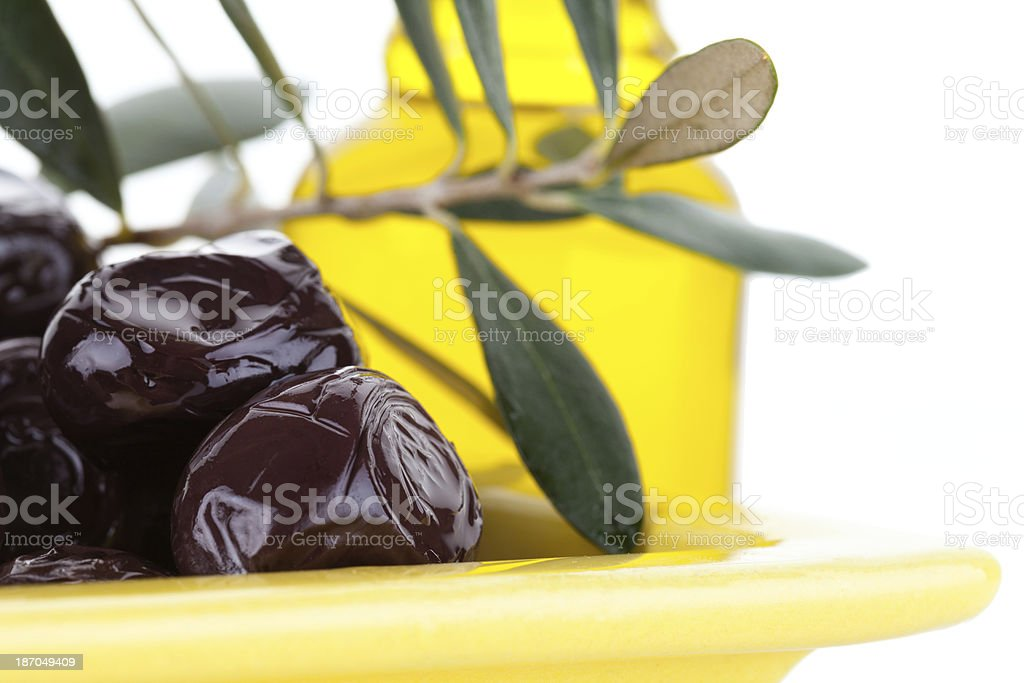 Organic Olive Leafs and Oil Bottle stock photo
