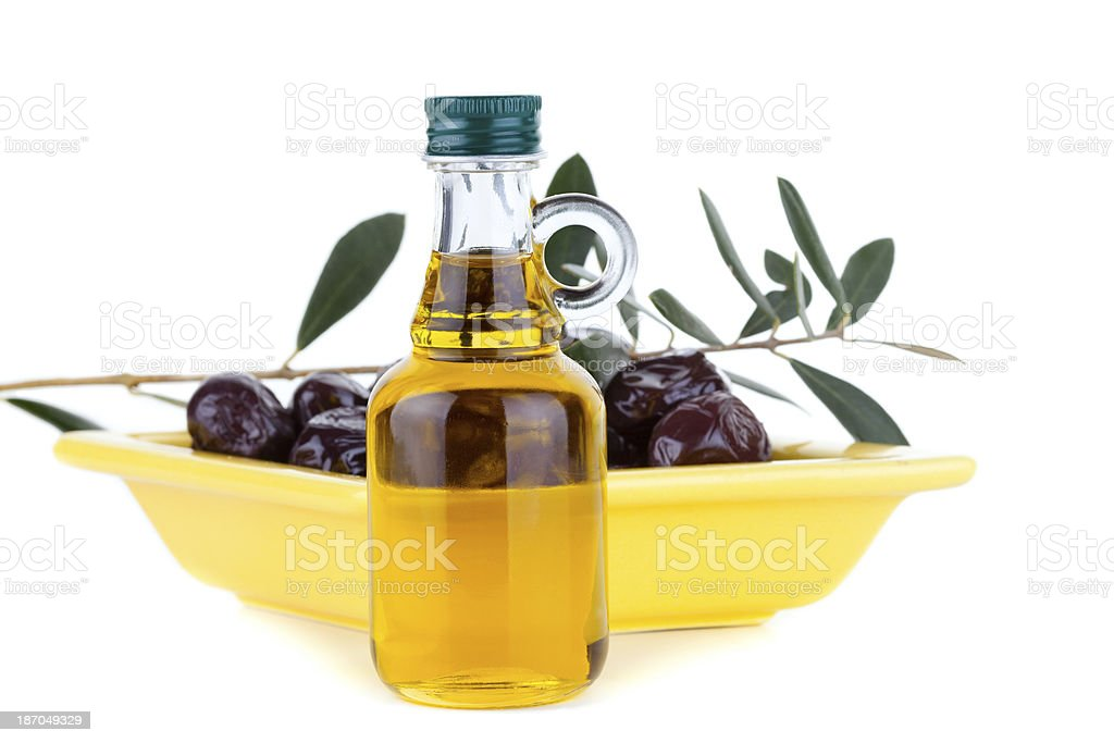 Organic Olive Leafs and Oil Bottles stock photo