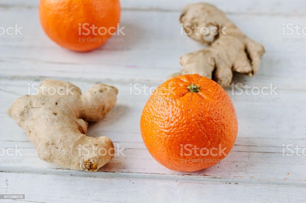 organic orange and ginger root stock photo