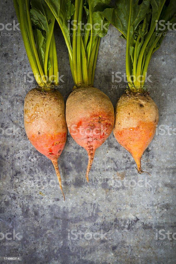 Organic Orange Beets On Old Wood royalty-free stock photo