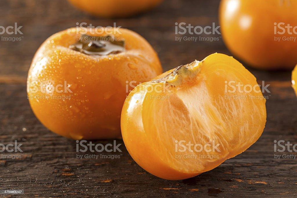 Organic Orange Persimmon Fruit stock photo
