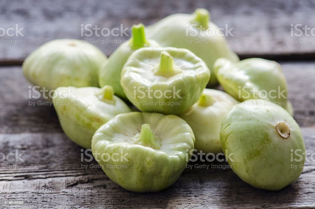 Organic pattypan squash on the wooden table stock photo
