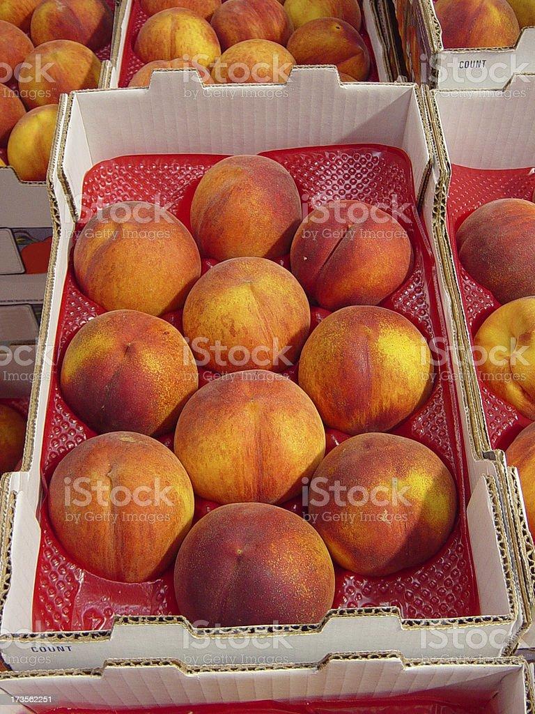 Organic Peaches in a Crate stock photo