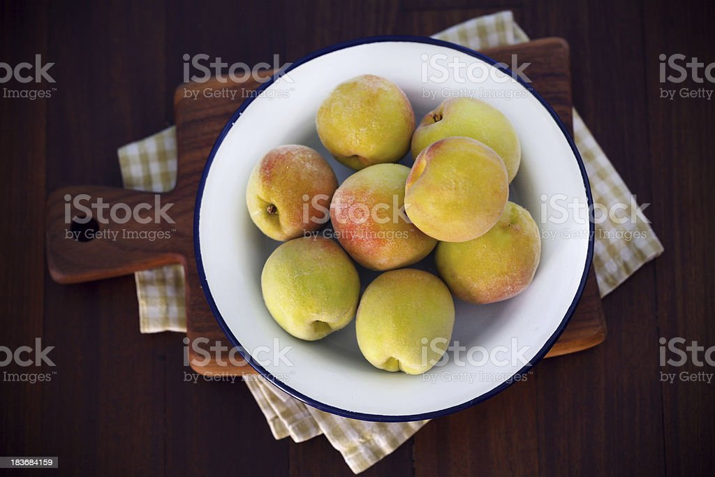 Organic peaches on  a platter in the country stock photo