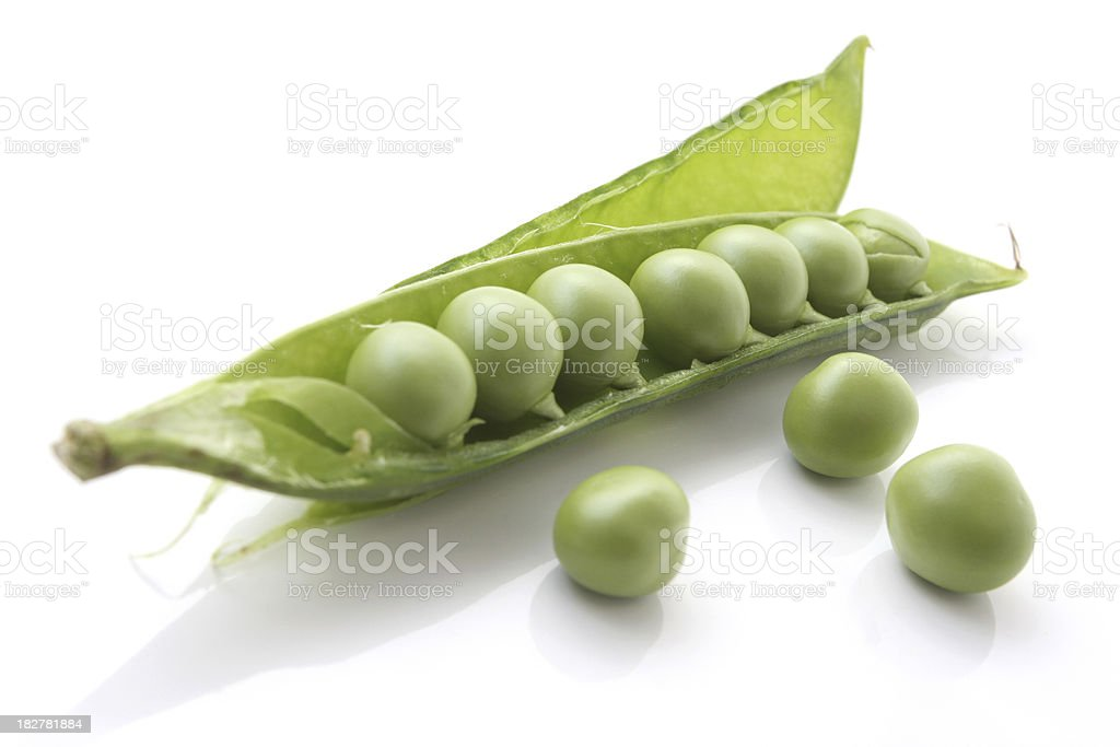 Organic Peas in a Peapod Isolated on White Background stock photo