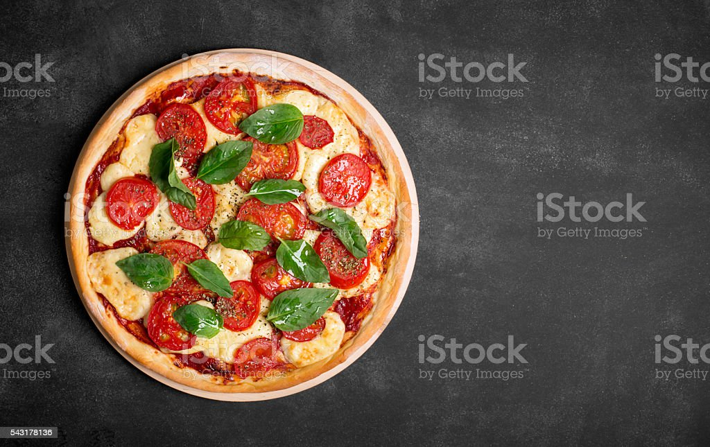 Organic pizza with vegetables and cheese stock photo