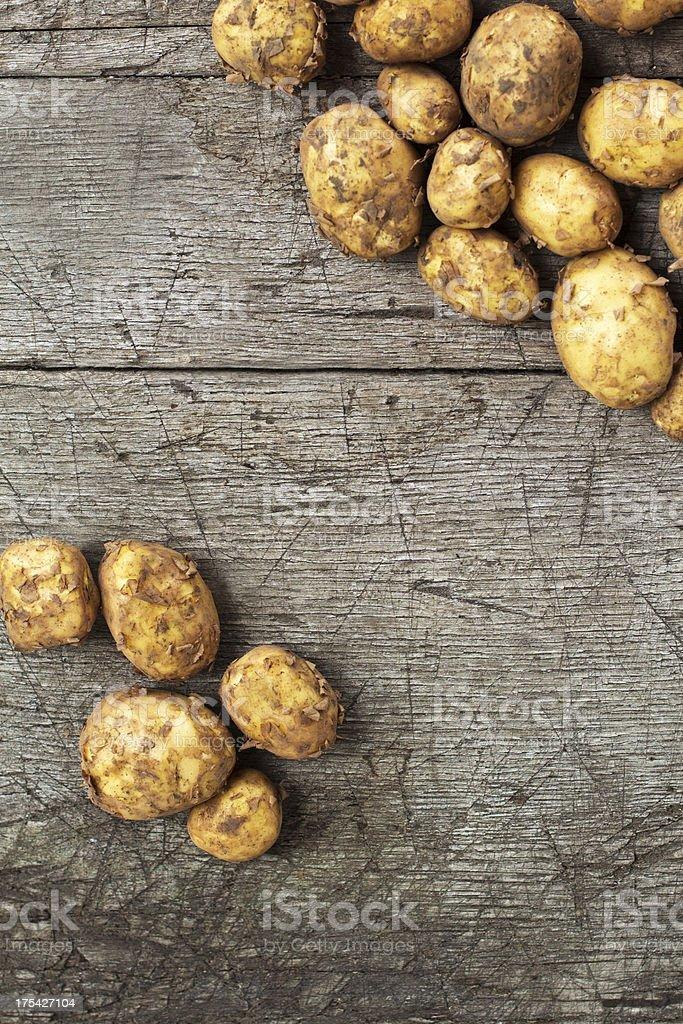 Organic Potatoes On An Old Wood Table stock photo