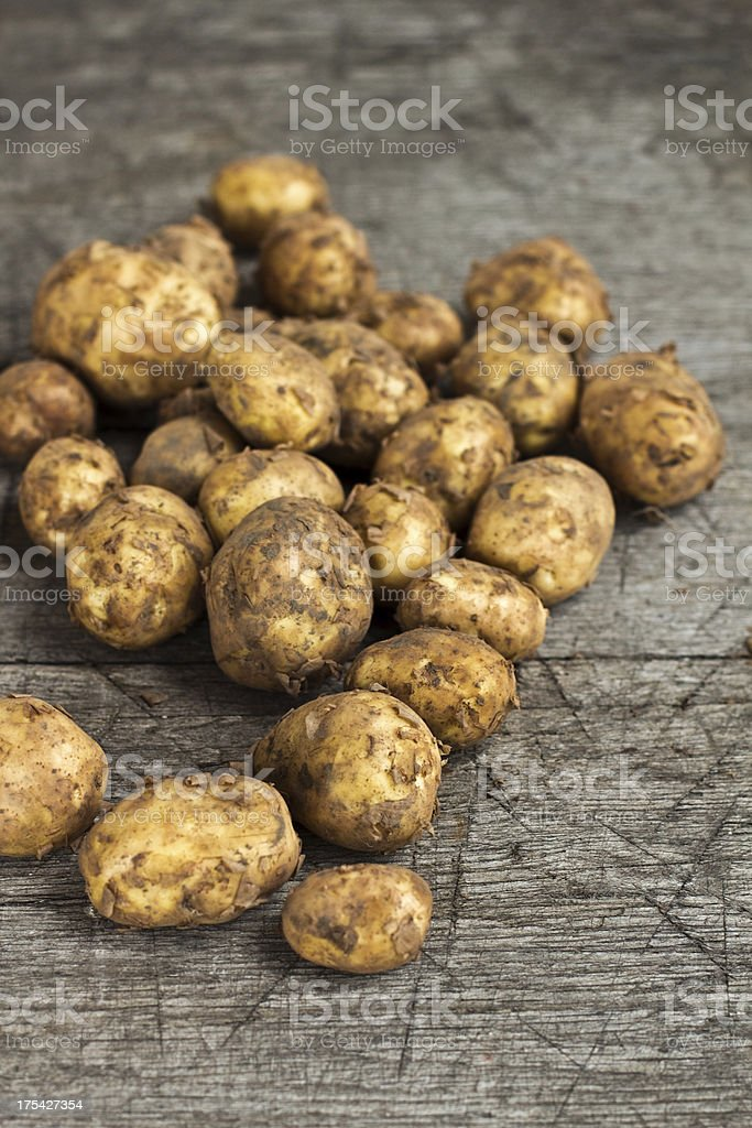 Organic Potatoes On An Old Wooden Table stock photo