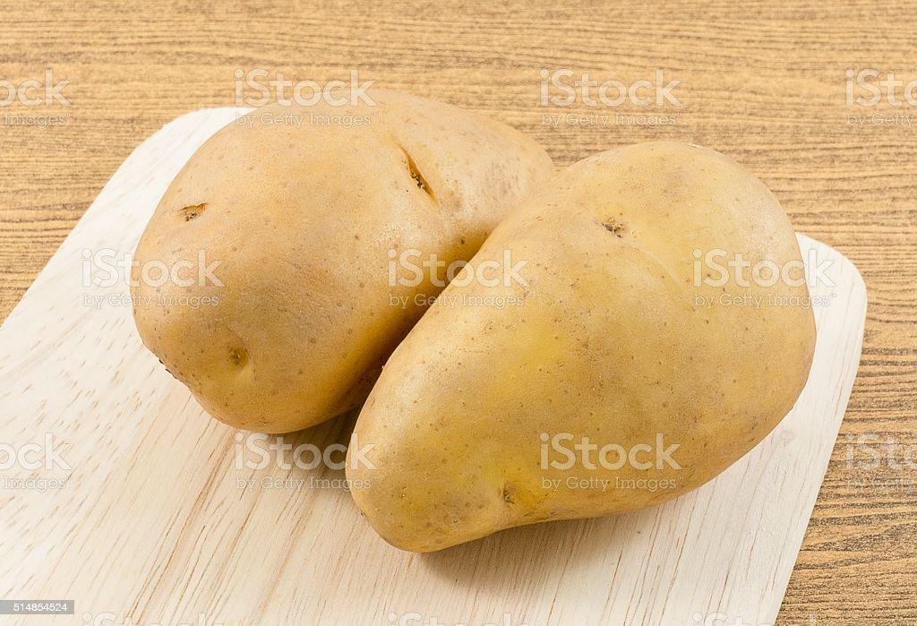 Organic Potatoes Tuber on A Cutting Board stock photo