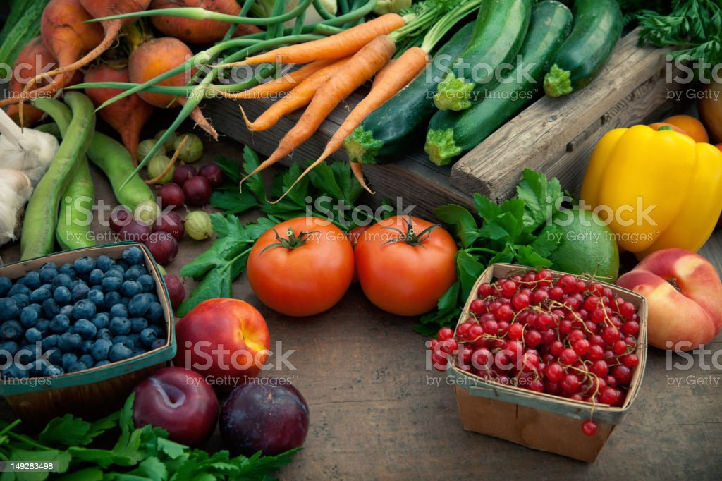 Organic produce pile on a brown table stock photo