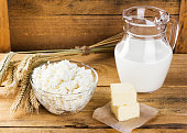 Organic products: milk, cottage cheese, butter, wheat on a woode