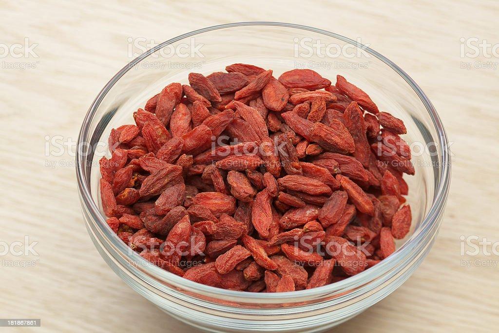 Organic raw goji berries in glass bowl royalty-free stock photo
